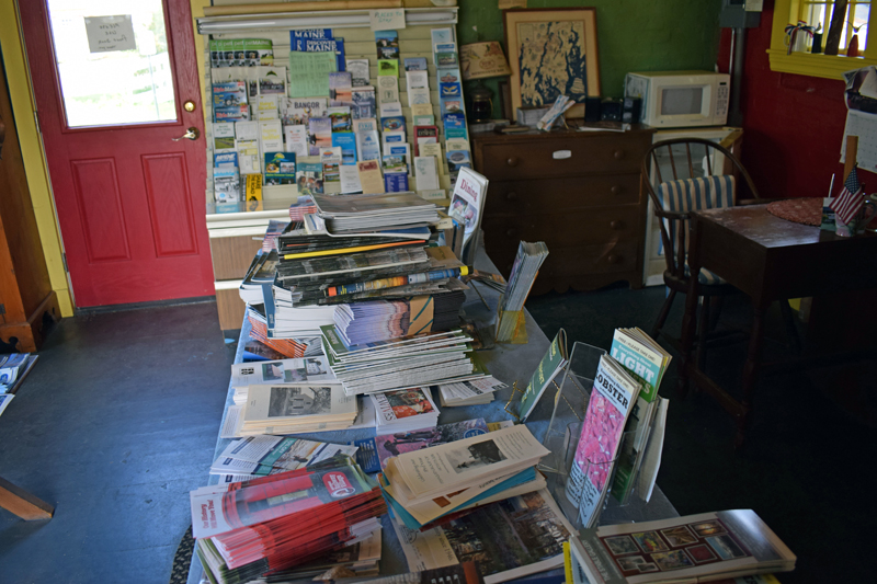 Brochures and other information about the area on a table inside the Damariscotta Region Information Bureau. The building closed in 2018. (Evan Houk photo)