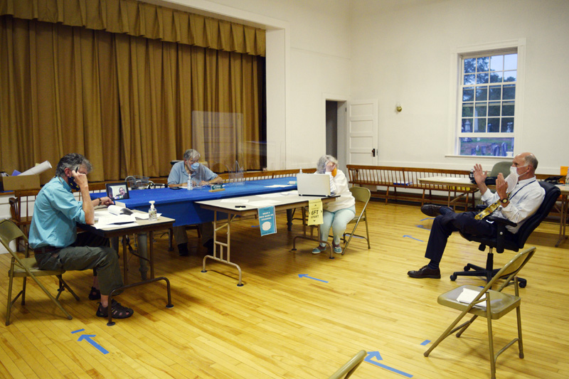 AOS 98 Superintendent Keith Laser (right) discusses changes to Edgecomb's education budget with the board of selectmen. From left: Selectmen Mike Smith, Ted Hugger (on tablet), and Jack Sarmanian; Town Clerk Claudia Coffin; and Laser. (Hailey Bryant photo)
