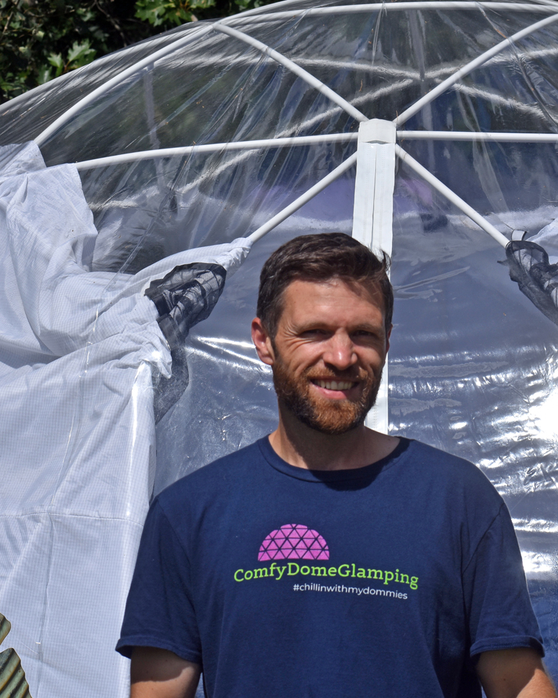 ComfyDome owner Seth Fraser in front of one of the three domes guests can rent on his property in Jefferson. (Alexander Violo photo)