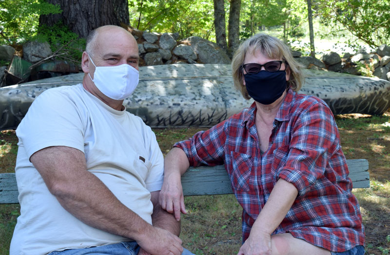 COVID-19 survivors Bob and Carolyn Hatch sit outside their Newcastle home on Saturday, Sept. 5. The Hatches urge everyone to remain vigilant with masking and physical distancing because of the severity of the illness. (Evan Houk photo)