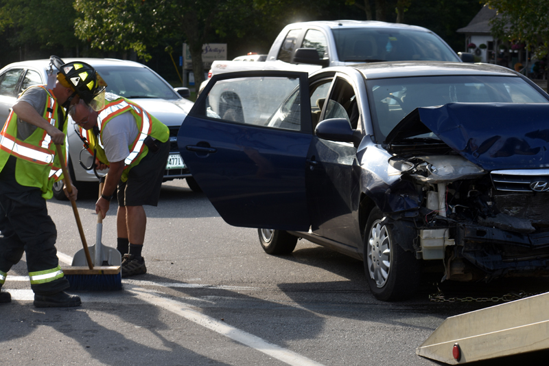 Waldoboro firefighters remove debris from the scene of a three-vehicle collision on Route 1 in Waldoboro, Thursday, Sept. 10. (Alexander Violo photo)
