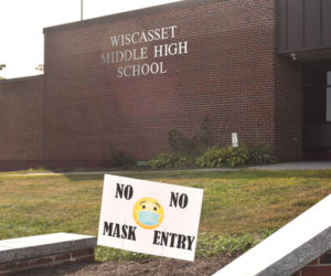 "A sign outside Wiscasset Middle High School says ""no mask, no entry."" (Hailey Bryant photo)"