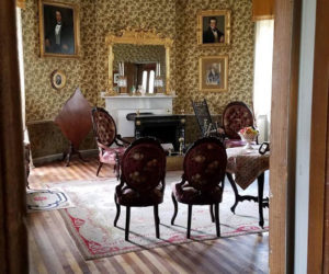 Views into preserved rooms at Castle Tucker provide a glimpse into history.