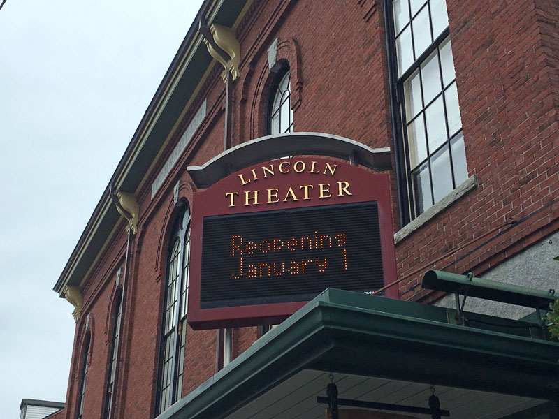 Lincoln Theater's Main Street marquee announces its reopening.