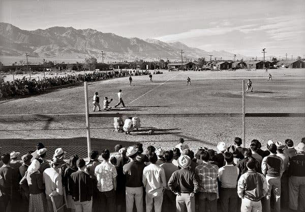Baseball lifted spirits at Japanese internment camps during World War II, as shown in this photo by Ansel Adams.