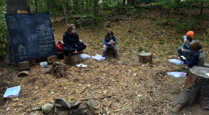 Robin Huntley, teacher and elementary education director at Juniper Hill School for Place-Based Education in Alna, teaches a math class outdoors Oct. 1. (Evan Houk photo)