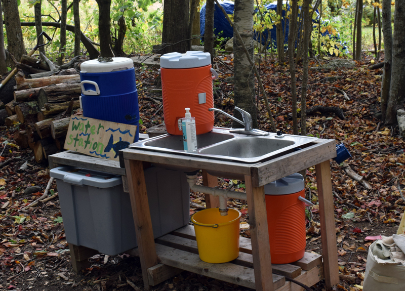 A hand-washing station is a new addition at Juniper Hill School for Place-Based Education this school year. (Evan Houk photo)
