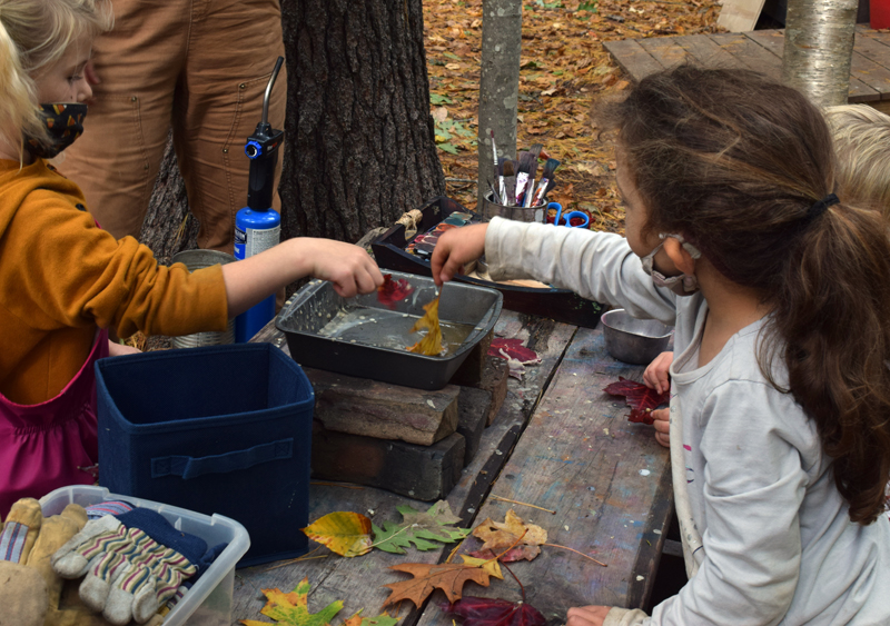 Students in the early childhood program at Juniper Hill School for Place-Based Education preserve leaves in wax on Oct. 1. (Evan Houk photo)