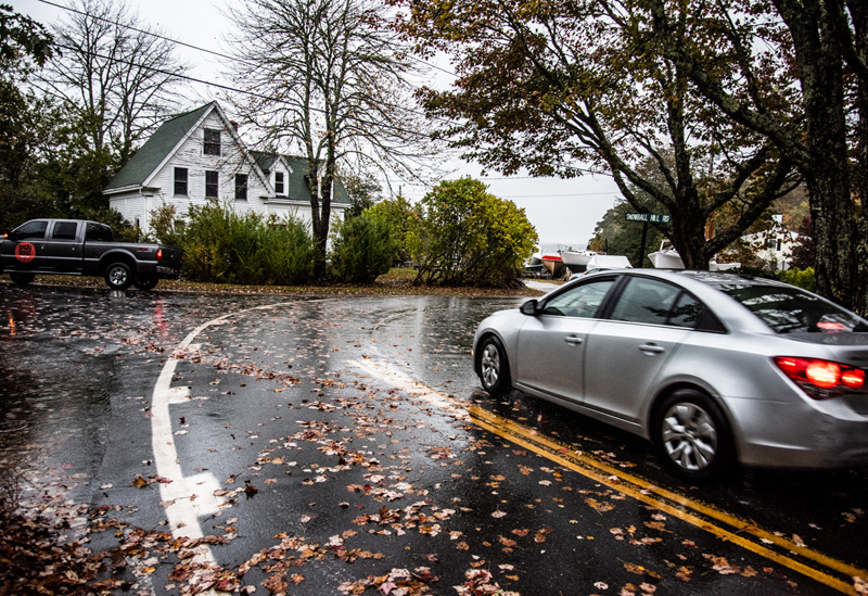 Vehicles navigate the intersection of Huddle Road and Snowball Hill Road in Pemaquid Beach village, Tuesday, Oct. 13. Village residents want changes in the area to address concerns about pedestrian and traffic safety. (Bisi Cameron Yee photo)
