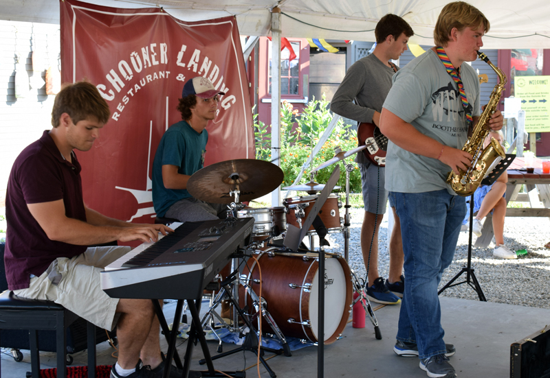 The Wharf Cats perform at Schooner Landing in Damariscotta on Aug. 8. From left: Tom Linkas, Nick Clifford, Ben Clifford, and Sam Hall. (Evan Houk photo)