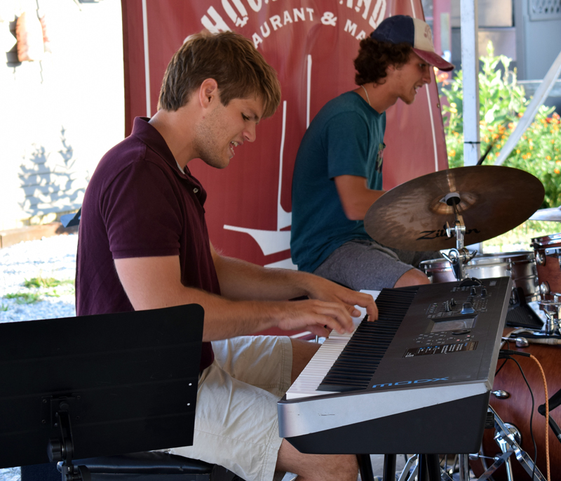 Tom Linkas jams out on the keyboard as Nick Clifford plays drums for the Wharf Cats at Schooner Landing in Damariscotta on Aug. 8. (Evan Houk photo)