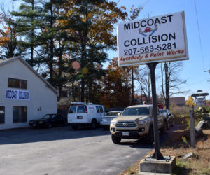 New signs advertise Midcoast Collision, formerly Scarborough's Collision, at 77 Biscay Road in Damariscotta. Dennis Hoppe, owner of the neighboring Quick Turn Auto Repair and Towing, has purchased the business. (Evan Houk photo)