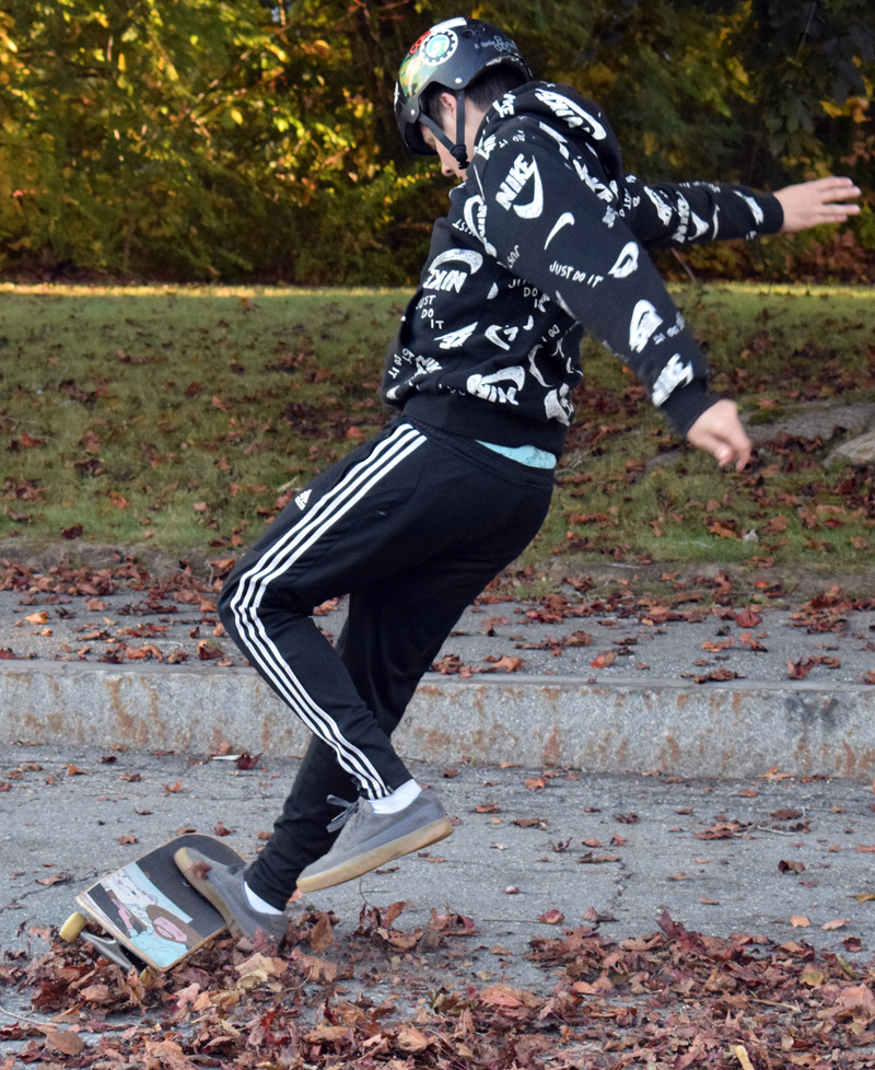 Adrian Oliver, a 13-year-old student at Great Salt Bay Community School, does a trick on a skateboard near the corner of Hodgdon and Church streets in Damariscotta on Monday, Oct. 5. The group of skateboarders has relocated from the area near Lincoln Theater and is seeking a permanent home. (Evan Houk photo)