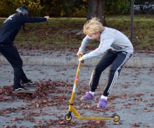 From left: Adrian Oliver and Fletcher Collamore, both 13, do tricks near the corner of Hodgdon and Church streets in Damariscotta on Monday, Oct. 5. The kids are working with parents and police to find a permanent place to skate. (Evan Houk photo)