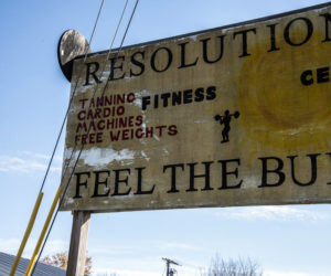 "The Resolutions Fitness Center sign invites passersby to ""feel the burn"" on Winslow Hills Road in Waldoboro, Thursday, Oct. 22. Resolutions closed permanently Saturday, Oct. 24. (Bisi Cameron Yee photo)"