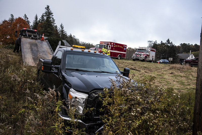 A wrecker pulls a truck out of roadside brush after a head-on collision at the intersection of Bristol Road and Harrington Road in Bristol, Thursday, Oct. 22.The crash occurred at 3:57 p.m. (Bisi Cameron Yee photo)