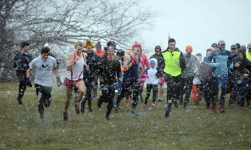 Runners plow full steam ahead at the snowy start of the 2019 race.