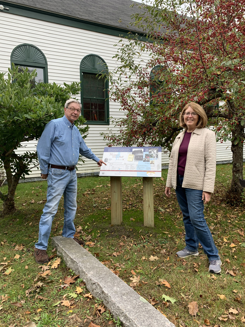 Dennis Dunbar and Jean Wilhelmsen-Exter reviewing the Interpretive sign at the Town Hall.