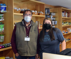 "David ""Big Dave"" Page, co-owner of Coastal Cannabis Co. LLC, and employee Sydney Dyer stand behind the counter at the Damariscotta storefront on Monday, Nov. 16. Coastal Cannabis is Lincoln County's first recreational cannabis shop. (Evan Houk photo)"