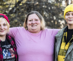 From left: Megan Farrar, Mariah Middleton-Rackliff, and Taylour Daniello in Jefferson on Saturday, Nov. 22. The family leads a local effort to bring the holidays to families in need. (Bisi Cameron Yee photo)