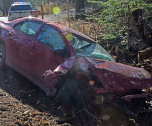 A red 2010 Toyota Corolla on the side of River Road in Newcastle after a crash Monday, Nov. 16. The driver was flown to a Lewiston hospital, according to police. (Evan Houk photo)
