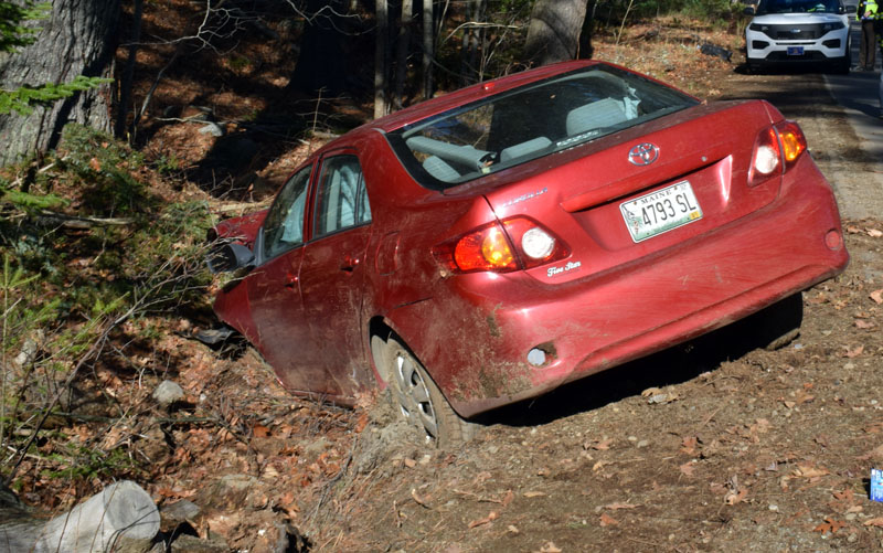 A red 2010 Toyota Corolla in a ditch off River Road in Newcastle after a crash on Monday, Nov. 16. The driver was flown to Central Maine Medical Center in Lewiston, according to police. (Evan Houk photo)