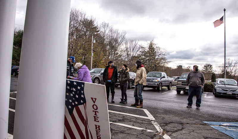 Voters wait in line at the Waldoboro municipal building Tuesday, Nov. 3. Waldoboro had 10 questions on a local ballot, including a much-debated referendum regarding the sale of A.D. Gray School. (Bisi Cameron Yee photo)