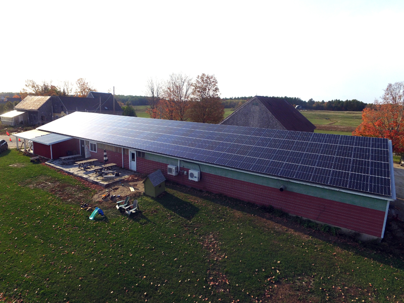 A 55-kilowatt solar array on the roof of Sheepscot General Store and Farm in Whitefield. (Photo courtesy Richard Simon)