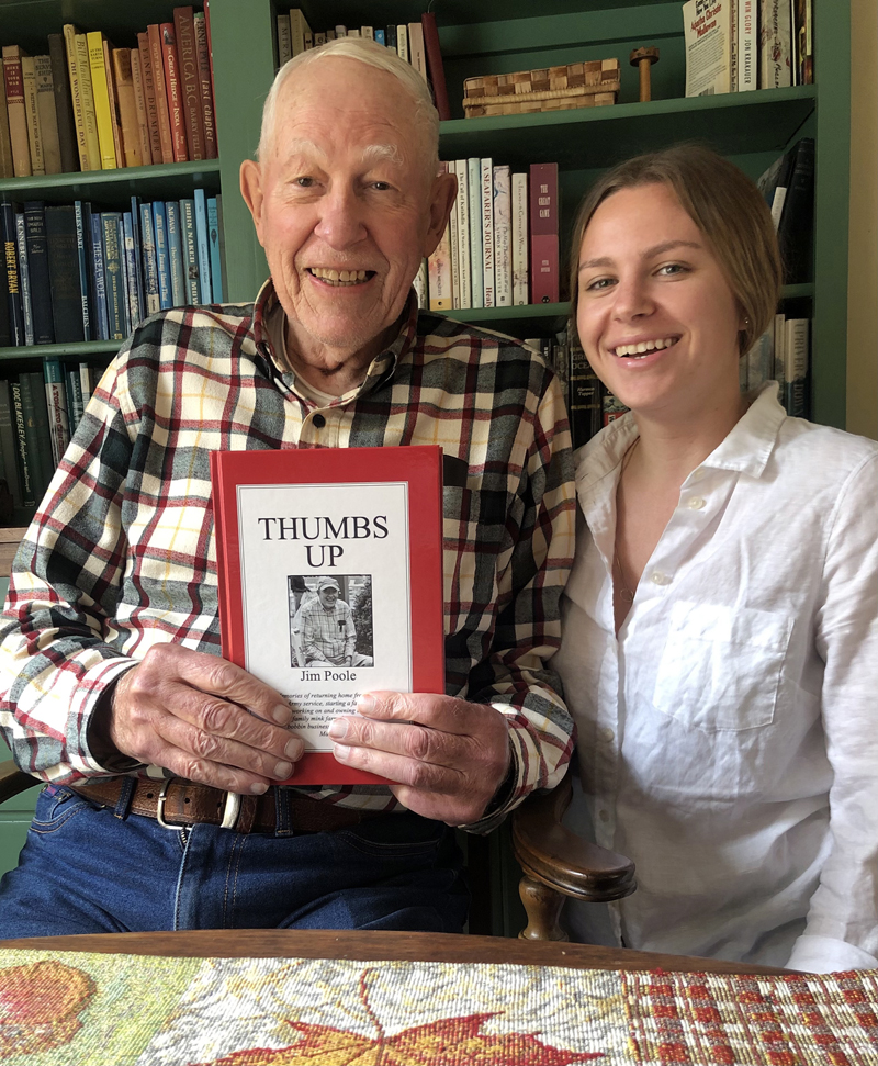 "Jim Poole holds his new book, ""Thumbs Up,"" with his granddaughter, Marina Poole."