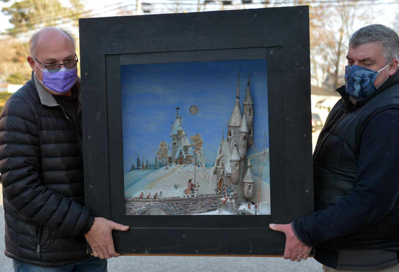Dirk Poole and Justin Day carry Jake Day's castle diorama. (Paula Roberts photo)