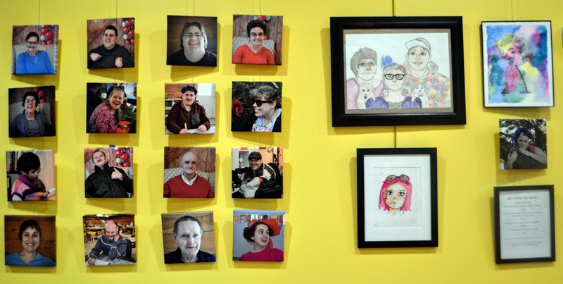 """Photos of Mobius client-artists' hang next to the art show, """"Art from the Heart II,"""" at the CLC YMCA."""