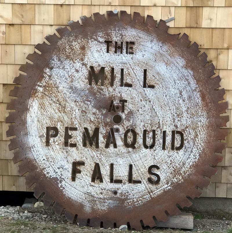 A massive 66-inch-diameter saw-blade sign rests against the Mill at Pemaquid Falls. A movable stand will soon be constructed. (Photo courtesy Mark Ziarnik)