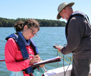 Coastal Rivers' volunteers take measurements and record water quality data on the Damariscotta River regularly throughout the summer months. (Photo courtesy Kris Christine)