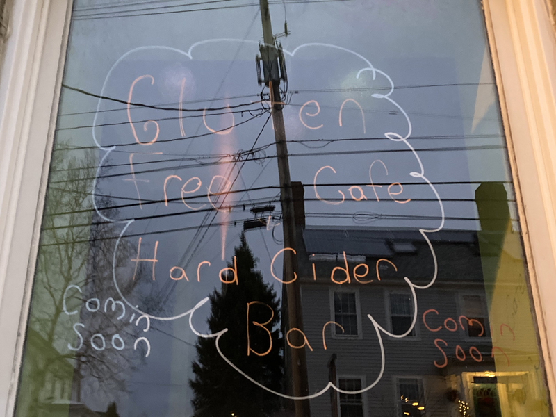 Writing on a window announces that a gluten-free cafe and hard cider bar will soon open at 133 Main St. in downtown Damariscotta. The business, Butter Up Cakes, has roots in Bangor. (Hailey Bryant photo)