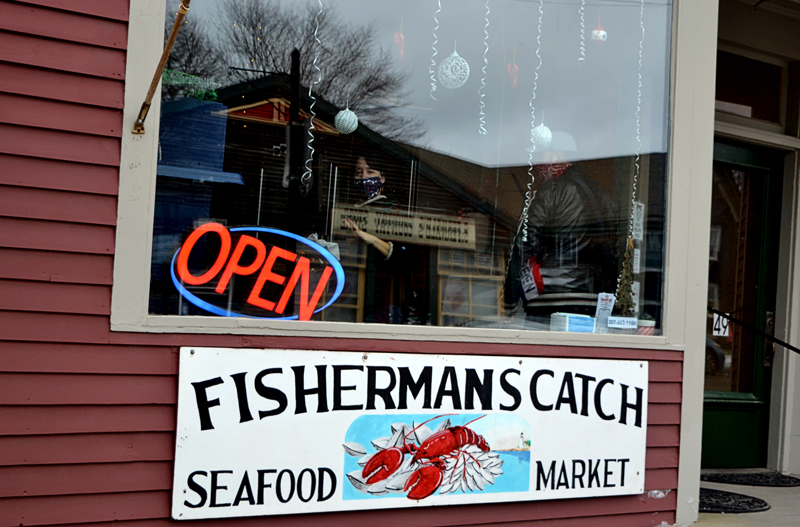 An open sign invites shoppers into Fisherman's Catch Seafood Market in downtown Damariscotta. Owner Jamie Moore plans to continue her family's legacy of selling fresh, quality seafood. (Nettie Hoagland photo)