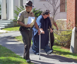 A pair of Lincoln County sheriff's deputies escort Matthew Fleury into the Lincoln County Courthouse in Wiscasset for sentencing on Sept. 14, 2007. Fleury would spend the next 13-plus years in prison, where he died Thursday, Nov. 26. (LCN file photo)