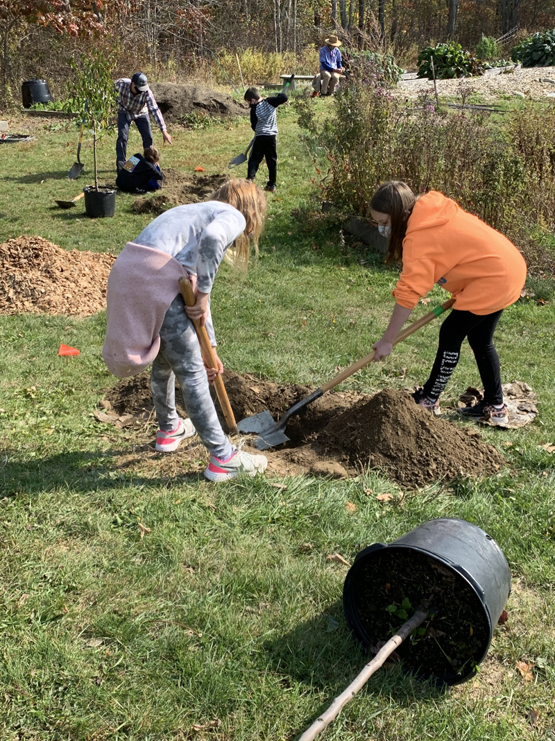 Students prepare to plant trees in a new orchard behind Great Salt Bay Community School in Damariscotta. The school plans to set up a greenhouse near the orchard by fall 2021. (Photo courtesy Margaret Coleman)