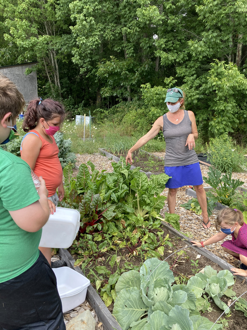 Margaret Coleman, agriculture coordinator at Great Salt Bay Community School in Damariscotta, shows summer campers the garden behind the school. The school plans to put up a greenhouse close to the garden by fall 2021. (Photo courtesy Margaret Coleman)