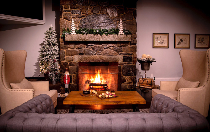 A fireplace and holiday decorations lend to the cozy atmosphere at Water's Edge Restaurant & Bar in Edgecomb. The pop-up restaurant aims to attract travelers en route to Gardens Aglow in Bothbay. (Photo courtesy Erin Stodder)