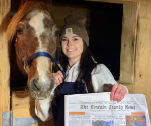 Brooke Alley holds a copy of the Oct. 29 edition of The Lincoln County News with her photo of Camelot on the front. The photo won the October contest before going on to win the annual contest. (Photo courtesy Brooke Alley)