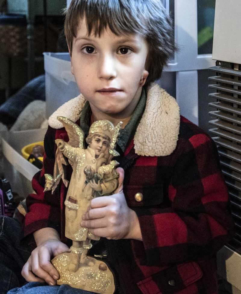 Hayden Libby holds a Christmas angel at his home in Waldoboro on Saturday, Dec. 19. Hayden's parents started a fundraiser for a surgery that would reconstruct his left ear and allow him to hear from it. (Bisi Cameron Yee photo)
