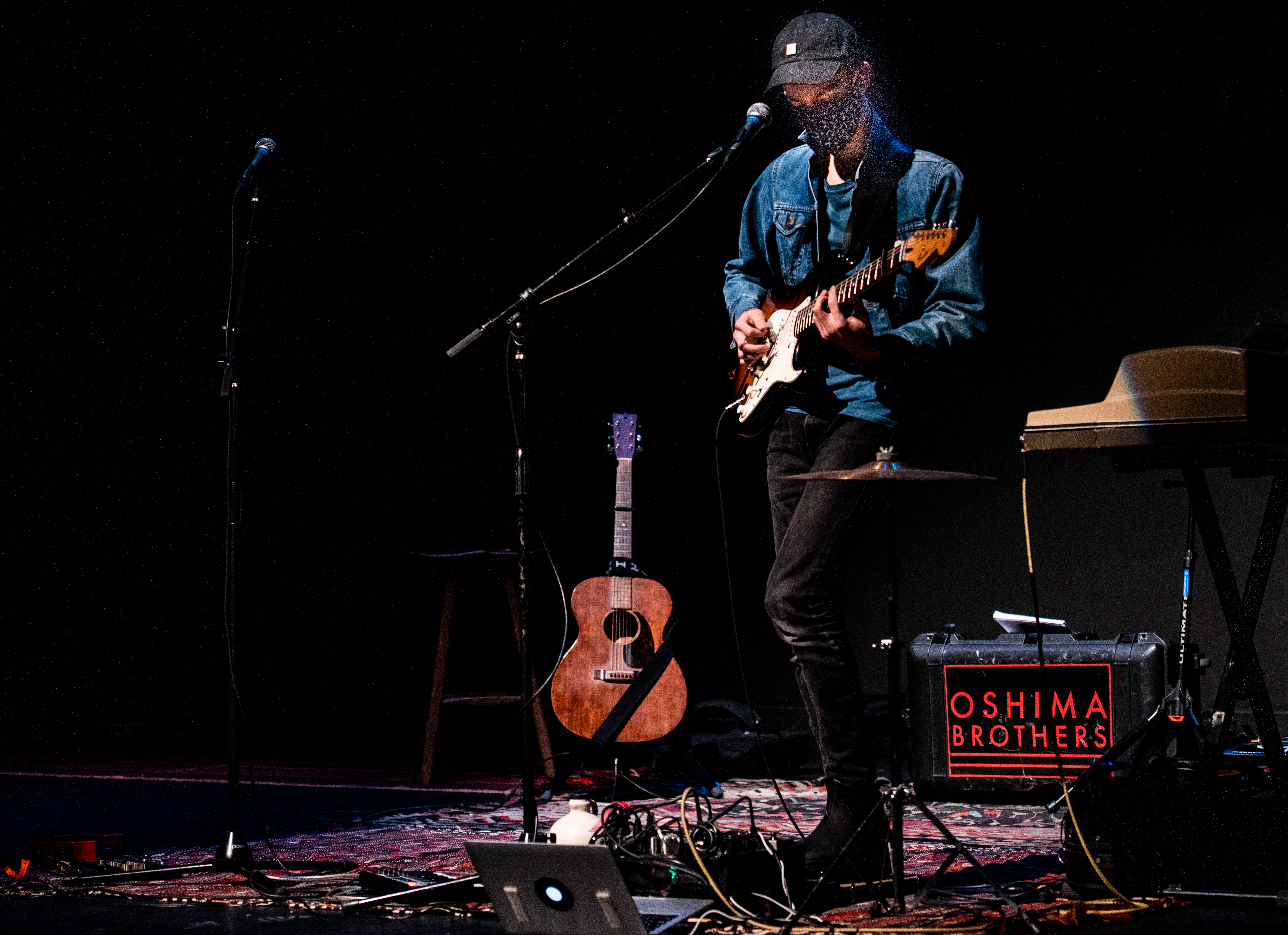 Jamie Oshima plays guitar during a sound check at the Waldo Theatre in Waldoboro on Thursday, Dec. 3. Jamie produces and audio engineers all the band's music. (Bisi Cameron Yee photo)