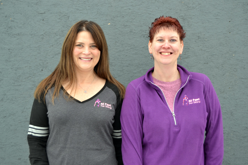 Julie Greenleaf (left) and Sarah Caton care for local animals through Caton's business, All Paws Pet Sitting. All Paws is celebrating five years in business.