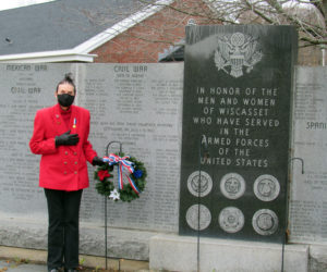 Clara Wentworth, of the Daughters of the American Revolution, lays a wreath at the Wiscasset veterans memorial for Veterans Day.