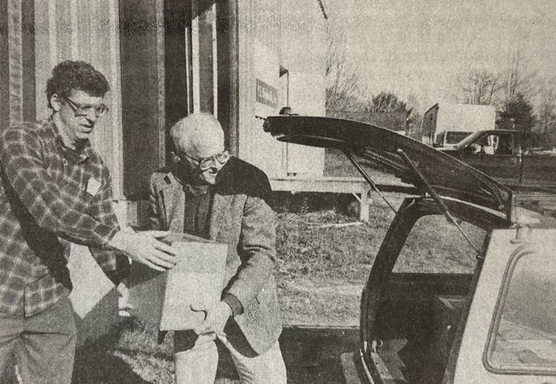 """Chris Roberts (left) helps Mark Biscoe load his car with copies of his then-new book, """"'No Pluckier Set of Men Anywhere': The Story of Ships and Men in Damariscotta and Newcastle, Maine"""" in a photo from the Nov. 17, 1994 edition of The Lincoln County News. The """"Waldoboro Wanderings"""" columnist died Saturday, Dec. 19 at the age of 84."""