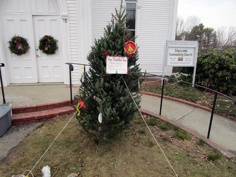 The Edgecomb Community Church Thankful Tree is ready for community members to add messages, ornaments, and photographs to express thankfulness.