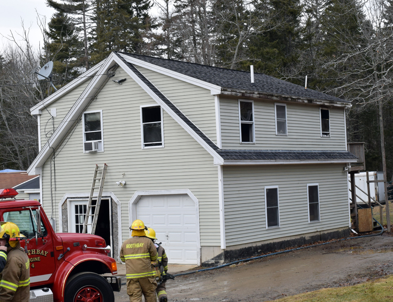 Firefighters clean up after a kitchen fire at 21 West Side Road on Barter's Island, Boothbay, Thursday, Dec. 31. Firefighters knocked down the second-floor blaze within about 15 minutes, Chief Dick Spofford said. (Evan Houk photo)