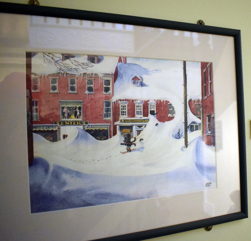 """A painting by the late Damariscotta artist Maurice """"Jake"""" Day depicts the Senter's Department Store, now the Damariscotta Center building. The painting hangs in a hallway of the building. (Evan Houk photo)"""