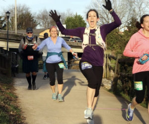 Amber Young runs a 100-mile race in Alcoa, Tenn. in March 2018. Young wears at least one article of purple clothing for every race in support of her daughter, who has epilepsy. (Photo courtesy Amber Young)