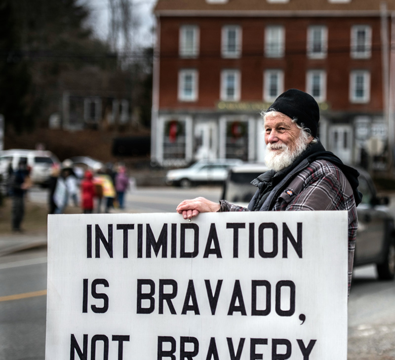 Clayton Herbert, of Damariscotta, joins more than 50 others to mark Martin Luther King Jr. Day with an anti-racism vigil in Newcastle. (Bisi Cameron Yee photo)
